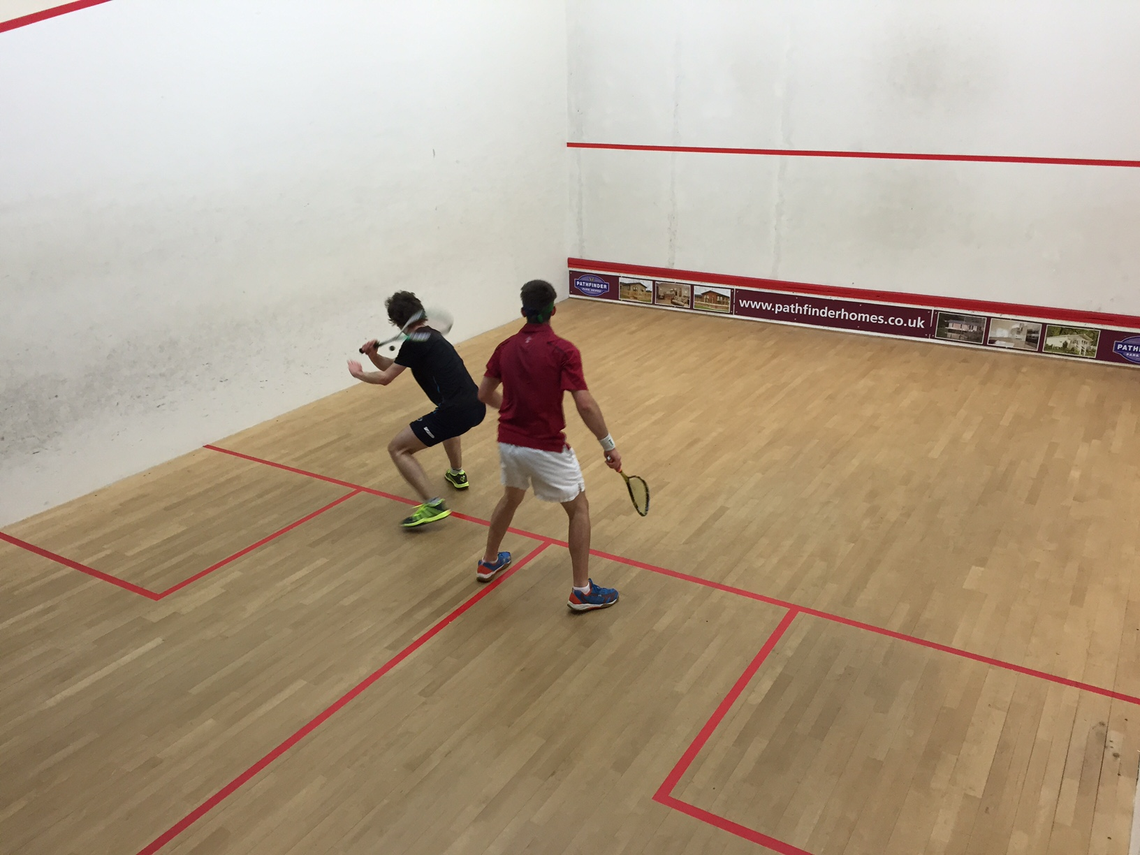 how to play squash uk